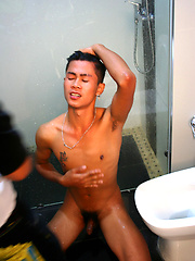 Cute asian boy shows his ass and gets pissed on.