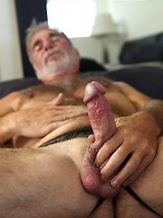Hot older man grabs his hairy dick