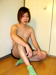 Japanese boy sitting on the floor and jerking