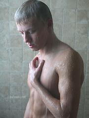 Pretty blonde college jock stroking his huge dick