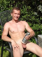 Martin Sanders masturbates with fleshlight outdoors.