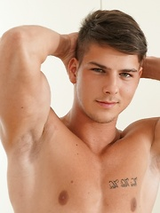 Muscle boy Andrew Gonzales jerks off after workout.