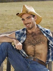Smiley cowboy man showing his nude hairy chest