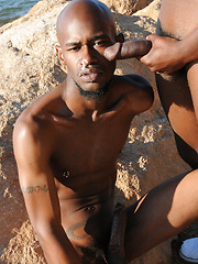 Ebony monsters Black Rod and Pleasure Boi in outdoor scene