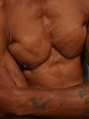 Bronzed guy shows his beefy body