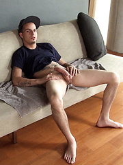 Jacob Pike sitting in the coach and stroking cock