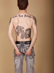 Tall skinny tattooed Pete Crash blows his load onto tummy.