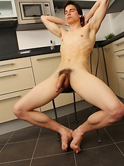 Hard bodied Brian Witter stroking his uncut cock.