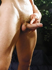 Ripped stud Miki stroking his firm cock.