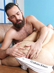 Rich Kelly, with his full beard and furry chest, the perfect top to get to work on your ass