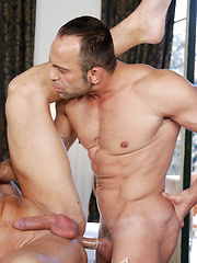 Alekos whips his cock out of Leo's ass and erupts his hot load all over Leo's huge thighs and balls